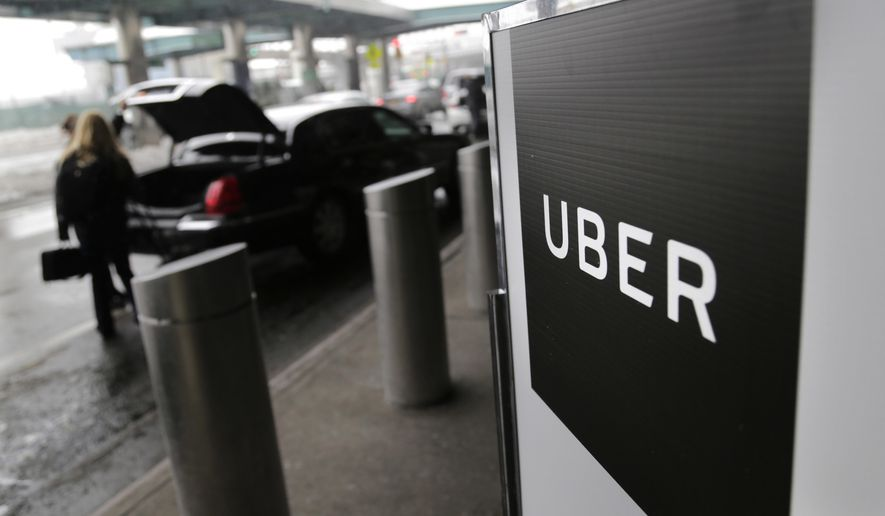 FILE - In this March 15, 2017 file photo, a sign marks a pick-up point for the Uber car service at LaGuardia Airport in New York. New York City is imposing a one-year moratorium on new ride-hailing licenses in Uber's largest U.S. market, raising the specter that other cities may adopt similar crackdowns as they try to ease traffic congestion. (AP Photo/Seth Wenig, File)