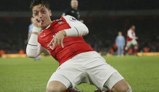 FILE - In this Saturday Dec. 10, 2016 file photo Arsenal's Mesut Ozil celebrates after scoring a goal during the English Premier League soccer match between Arsenal and Stoke City at the Emirates stadium in London. (AP Photo/Tim Ireland)
