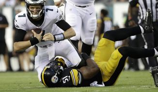 Philadelphia Eagles' Nate Sudfeld (7) is tackled by Pittsburgh Steelers' Jon Bostic (51) during the first half of a preseason NFL football game Thursday, Aug. 9, 2018, in Philadelphia. (AP Photo/Michael Perez) **FILE**