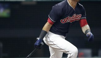 Cleveland Indians' Leonys Martin watches his sacrifice fly in the eighth inning of a baseball game against the Minnesota Twins, Tuesday, Aug. 7, 2018, in Cleveland. Michael Brantley scored on the play. (AP Photo/Tony Dejak)
