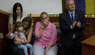 The family of lawmaker Juan Requesens, father Juan Requesens, right, mother Paula Martinez, center, sister Rafalea, left, and wife Oriana Granati attend a special session of Venezuela's National Assembly, in Caracas, Venezuela, Thursday, Aug. 9, 2018. VVenezuela's pro-government constitutional assembly stripped two opposition lawmakers of their immunity from prosecution on Wednesday, one of them Juan Requesens, accusing them of having roles in a drone attack that authorities say was an attempt to kill President Nicolas Maduro. (AP Photo/Fernando Llano)