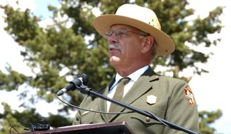 FILE - In this Aug. 17, 2017 file photo, Yellowstone Superintendent Dan Wenk speaking at an event marking a conservation agreement for a former mining site just north of the park in Jardine, Mont. Wenk will retire September 29 after declining an unwanted transfer to Washington, D.C.. (AP Photo/Matthew Brown, File)