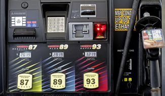 FILE- In this June 14, 2018, file photo,  gasoline prices are displayed on a pump at Sheetz along the Interstate 85 and 40 corridor near Burlington, N.C. On Friday, Aug. 10, the Labor Department reports on U.S. consumer prices for July. (AP Photo/Gerry Broome, File)