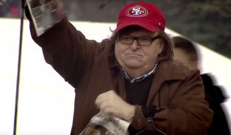 "Filmmaker Michael Moore rips a newspaper with President Trump's visage on the front page during the trailer for his new ""Fahrenheit11/9"" documentary. (Image: YouTube, Michael Moore)   **FILE**"