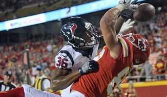 Houston Texans cornerback Josh Thornton (36) breaks up a pass in the end zone which was intended for Kansas City Chiefs tight end Alex Ellis (82) during the second half of an NFL preseason football game in Kansas City, Mo., Thursday, Aug. 9, 2018. The Texans won 17-10. (AP Photo/Ed Zurga)