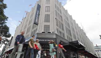Pedestrians walk past the House of Fraser department store on Oxford Street in London, Friday, Aug. 10, 2018.  British retailer Sports Direct said Friday that it has bought struggling department store chain House of Fraser, just hours after the 169-year-old business went into administration. (AP Photo/Frank Augstein)