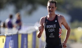 Alistair Brownlee of Great Britain participates in the running discipline of the men's triathlon finals at Strathclyde Country Park during the European Championships in North Lanarkshire, Scotland, Friday, Aug. 10, 2018. (AP Photo/Darko Bandic)