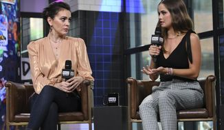 """Actors Alyssa Milano, left, and Debby Ryan participate in the BUILD Speaker Series to discuss the new Netflix original series """"Insatiable"""" at AOL Studios on Tuesday, Aug. 7, 2018, in New York. (Photo by Evan Agostini/Invision/AP)"""