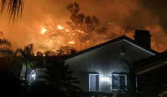 The Holy Fire burns in the Cleveland National Forest at a hillside near homes in Lake Elsinore, Calif., Thursday, Aug. 9, 2018. (AP Photo/Ringo H.W. Chiu)