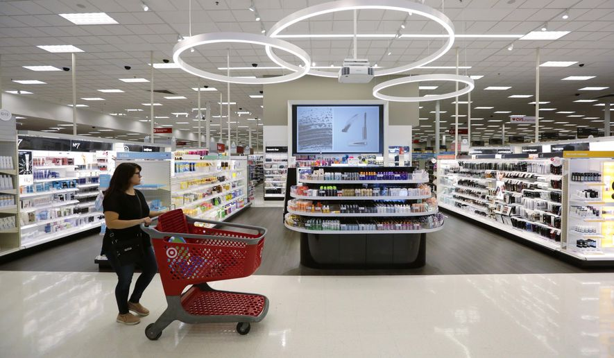 In this May 30, 2018, file photo, a shopper walks through the updated cosmetic department at a Target store in San Antonio. (AP Photo/Eric Gay, File)