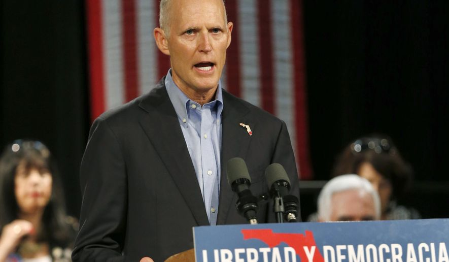 FILE- In this July 13, 2018 file photo, Florida Gov. Rick Scott, speaks to Cuban-American supporters at a campaign stop, in Hialeah, Fla. Scott, calling the allegations sensational, demanded on Friday, Aug. 10, 2018, that U.S. Sen. Bill Nelson provide proof to back up his statement that Russian operatives have penetrated some of his state's election systems ahead of this year's crucial election. (AP Photo/Wilfredo Lee, File)