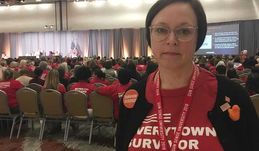 Jennifer Lugar poses for a photo Friday, Aug. 10, 2018, during the kickoff event for Gun Sense University, a two-day conference in Atlanta put on by gun safety advocacy group Moms Demand Action for Gun Sense in America. Lugar said she was inspired, in part by her work for Moms Demand Action during the 2016 election, to apply to fill an empty seat on the borough council in Jenkintown, Pennsylvania, where she lives. (AP Photo/Kate Brumback)