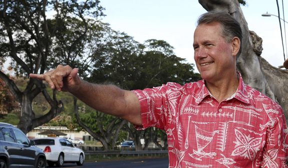 In this July 24, 2018, file photo, former U.S. Rep. Ed Case greets evening commuters while campaigning for the U.S. congressional seat representing urban Honolulu, in Honolulu. (AP Photo/Audrey McAvoy, File)