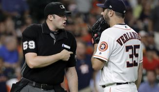 Houston Astros starting pitcher Justin Verlander (35) talks with home plate umpire Nic Lentz (59) after being called for a balk during the second inning of the team's baseball game against the Seattle Mariners on Thursday, Aug. 9, 2018, in Houston. (AP Photo/David J. Phillip)
