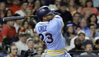 Seattle Mariners' Nelson Cruz watches a two-run double against the Houston Astros during the eighth inning of a baseball game Friday, Aug. 10, 2018, in Houston. (AP Photo/David J. Phillip)
