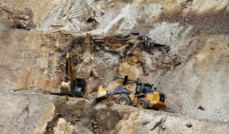 FILE - In this Aug. 12, 2015, file photo, heavy machinery works to repair damage at the Gold King Mine outside Silverton, Colo., where the U.S. Environmental Protection Agency inadvertently triggered a spill of 3 million gallons of wastewater. A fifth lawsuit was filed Aug. 3, 2018, against the EPA by Navajo farmers and ranchers seeking about $75 million in damages. The lawsuit says the farmers and ranchers lost crops and livestock and had to pay to haul clean water because they could not use rivers tainted by the spill. (AP Photo/Brennan Linsley, File)