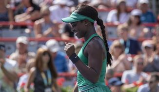 Sloane Stephens of the United States celebrates her victory over Anastasija Sevastova of Latvia during quarterfinals play at the Rogers Cup tennis tournament Friday, Aug. 10, 2018 in Montreal. (Paul Chiasson/The Canadian Press via AP)