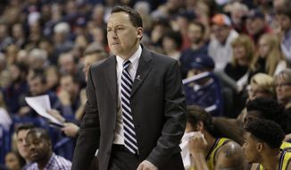 FILE - In this Nov. 18, 2015, file photo, Northern Arizona coach Jack Murphy watches during the second half of the team's NCAA college basketball game against Gonzaga in Spokane, Wash. Northern Arizona set a record for losses last season has had its worst three-year stretch in 27 years. Murphy said something needs to change. (AP Photo/Young Kwak, File)