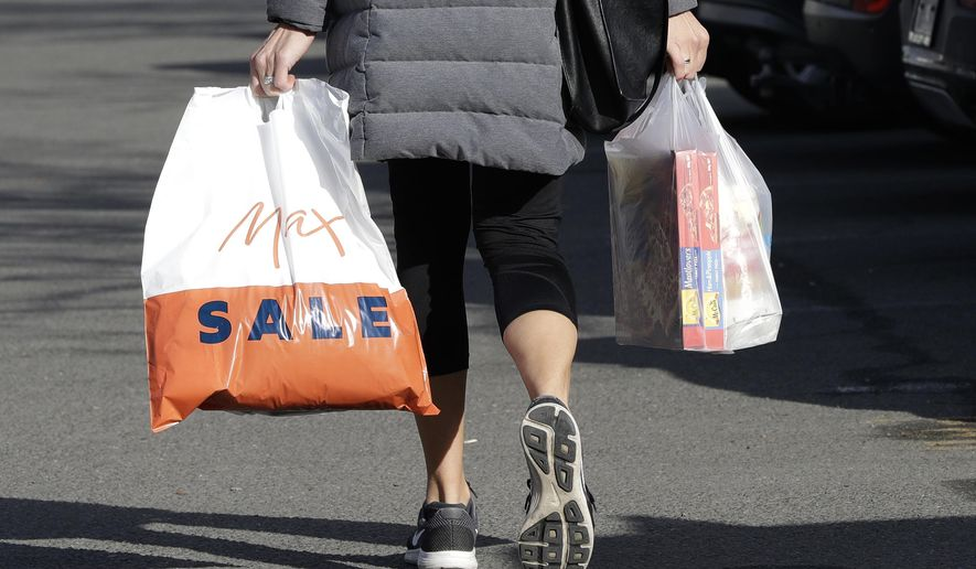 A shopper leaves a supermarket with goods in plastic bags in Christchurch, New Zealand, Friday, Aug. 10, 2018, in this file photo.  (AP Photo/Mark Baker) **FILE**