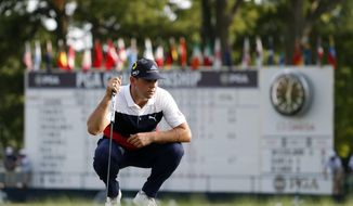 Gary Woodland looks at a putt on the 18th green during the first round of the PGA Championship golf tournament at Bellerive Country Club, Thursday, Aug. 9, 2018, in St. Louis. (AP Photo/Jeff Roberson)