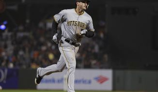 Pittsburgh Pirates' David Freese runs the bases after hitting a three-run home run off San Francisco Giants relief pitcher Derek Law during the seventh inning of a baseball game Thursday, Aug. 9, 2018, in San Francisco. (AP Photo/Eric Risberg)