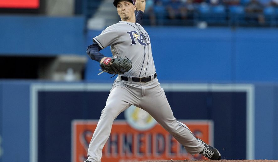 Tampa Bay Rays starting pitcher Blake Snell throws to a Toronto Blue Jays batter during the first inning of a baseball game Friday, Aug. 10, 2018, in Toronto. (Fred Thornhill/The Canadian Press via AP)