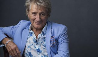 """Rod Stewart poses for a portrait on Wednesday, Aug. 8, 2018 in New York to promote his tour and upcoming album, """"Blood Red Roses."""" (Photo by Drew Gurian/Invision/AP)"""