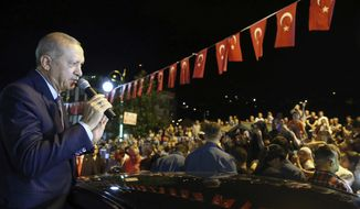 """Turkey's President Recep Tayyip Erdogan addresses supporters at his Black Sea hometown, Guneysu, Turkey, early Friday, Aug. 10, 2018. Turkey's Finance and Treasury Minister Berat Albayrak will reveal a """" new economic model """" as the Turkish Lira has lost more than 30 percent of its value since the start of the year. (Presidential Press Service via AP, Pool)"""