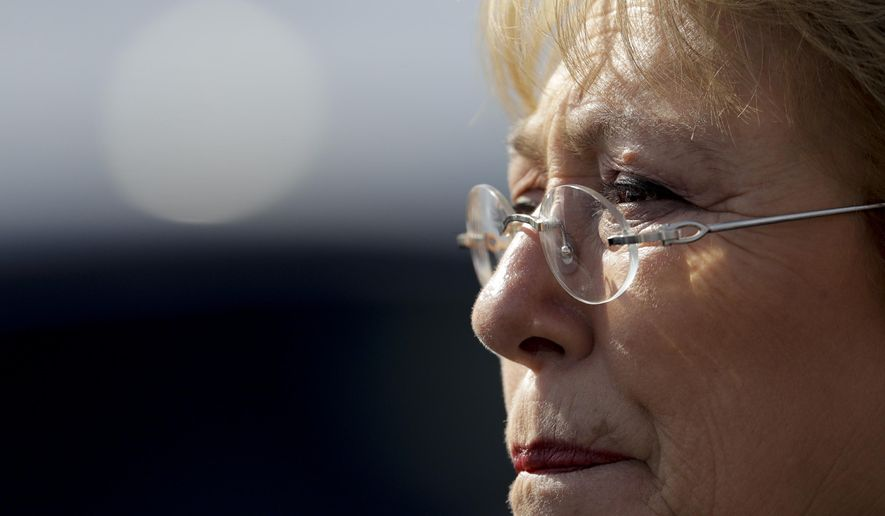 FILE - In this July 20, 2017, file photo, Chile's President Michelle Bachelet looks on during a visit to Memory Park which honors the victims of the country's dictatorship, in Buenos Aires, Argentina. The U.N. General Assembly on Friday, Aug. 10, 2018, approved Bachelet as the next U.N. human rights chief by consensus. (AP Photo/Natacha Pisarenko, File)