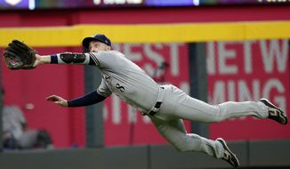 Milwaukee Brewers left fielder Ryan Braun makes a diving catch of a line drive off the bat of Atlanta Braves' Ender Inciarte in the seventh inning of a baseball game Saturday, Aug. 11, 2018, in Atlanta. (AP Photo/John Bazemore)