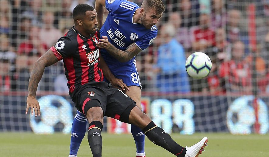 Bournemouth's Callum Wilson, left, and Cardiff City's Joe Ralls during their English Premier League soccer match at the Vitality Stadium in Bournemouth, England, Saturday Aug. 11, 2018. (Mark Kerton/PA via AP)