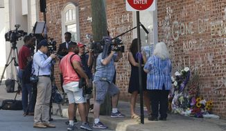 Susan Bro, mother of Heather Heyer who was killed during last year's Unite the Right rally, speaks with reporters at the spot where her daughter was killed in Charlottesville, Va., Friday, Aug. 10, 2018. The governor has declared a state of emergency in anticipation of the anniversary of the rally. (AP Photo/Steve Helber)