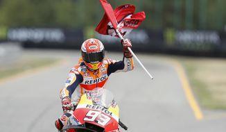 Third placed Spain's rider Marc Marquez of the Repsol Honda Team celebrates after the MotoGP race at the Czech Republic motorcycle Grand Prix at the Automotodrom Brno, in Brno, Czech Republic, Sunday, Aug. 5, 2018. (AP Photo/Petr David Josek)