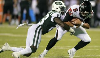 New York Jets' Terrence Brooks (23) tackles Atlanta Falcons' Kurt Benkert (6) during the second half of a preseason NFL football game Friday, Aug. 10, 2018, in East Rutherford, N.J. (AP Photo/Bill Kostroun)