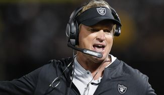 Oakland Raiders coach Jon Gruden reacts during the first half of the team's NFL preseason football game against the Detroit Lions in Oakland, Calif., Friday, Aug. 10, 2018. (AP Photo/John Hefti)