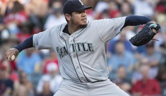 Seattle Mariners starting pitcher Felix Hernandez delvers a pitch during the first inning of the team's baseball game against the Los Angeles Angels in Anaheim, Calif., Saturday, July 28, 2018. (AP Photo/Kyusung Gong)