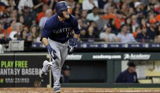 Seattle Mariners' Chris Herrmann drops his bat after hitting an RBI-triple against the Houston Astros during the fourth inning of a baseball game Saturday, Aug. 11, 2018, in Houston. (AP Photo/David J. Phillip)