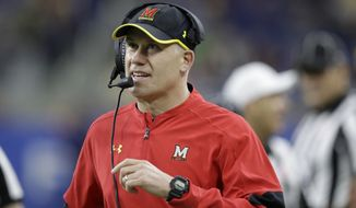 FILE - In this Dec. 26, 2016, file photo, Maryland head coach DJ Durkin walks the sideline during the first half of the Quick Lane Bowl NCAA college football game against Boston College in Detroit. Maryland placed the head of the football team's strength and conditioning staff on paid leave while it investigates claims he verbally abused and humiliated players, a person briefed on the situation said. The person spoke to The Associated Press on Saturday, Aug. 11, 2018, on condition of anonymity because Maryland had not announced the decision regarding Rick Court. The person says athletic director Damon Evans spoke with the football team Saturday morning and Durkin was still leading the program.  (AP Photo/Carlos Osorio) ** FILE **