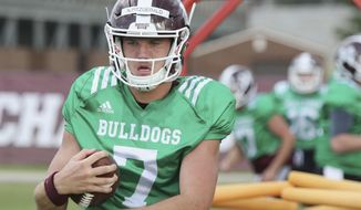 Mississippi State quarterback Nick Fitzgerald (7) runs through a blocking drill during an NCAA college football practice in Starkville, Miss., Friday, Aug. 10, 2018. (AP Photo/Jim Lytle)