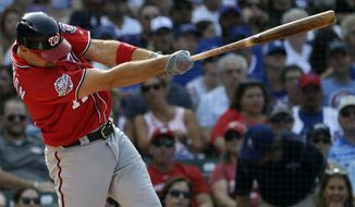 Washington Nationals' Ryan Zimmerman hits a three-run home run against the Chicago Cubs during the fourth inning of a baseball game Saturday, Aug. 11, 2018, in Chicago. (AP Photo/Nam Y. Huh)