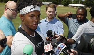 FILE - In this Tuesday, Aug. 7, 2018, file photo, Oklahoma quarterback Kyler Murray talks with the media following an NCAA college football practice in Norman, Okla. The first-round Major League Baseball draft pick has signed for nearly $5 million to play for the Oakland Athletics. Yet, he's fully committed to football for one year, and if he can beat out Austin Kendall for the starting job, the speedster could be one of college football's most electrifying players.  (AP Photo/Sue Ogrocki, File)