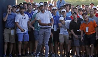Tony Finau watches his second shot on the 10th hole during the first round of the PGA Championship golf tournament at Bellerive Country Club, Thursday, Aug. 9, 2018, in St. Louis. (AP Photo/Jeff Roberson)