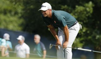 Adam Scott, of Australia, checks the 12th green during the third round of the PGA Championship golf tournament at Bellerive Country Club, Saturday, Aug. 11, 2018, in St. Louis. (AP Photo/Brynn Anderson)