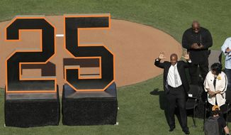 Former San Francisco Giants player Barry Bonds waves to fans next to his mother, Pat, as he is honored during a ceremony to retire his jersey number before a baseball game between the Giants and the Pittsburgh Pirates in San Francisco, Saturday, Aug. 11, 2018. (AP Photo/Jeff Chiu, Pool)