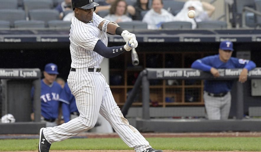 New York Yankees' Miguel Andujar hits a two-run home run during the seventh inning of a baseball game against the Texas Rangers Saturday, Aug. 11, 2018, at Yankee Stadium in New York. (AP Photo/Bill Kostroun)