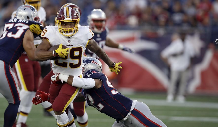 New England Patriots linebacker Elandon Roberts (52) tackles Washington Redskins running back Derrius Guice (29) during the first half of a preseason NFL football game, Thursday, Aug. 9, 2018, in Foxborough, Mass. (AP Photo/Charles Krupa)