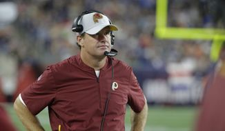Washington Redskins head coach Jay Gruden watches from the sideline during the first half of a preseason NFL football game against the New England Patriots, Thursday, Aug. 9, 2018, in Foxborough, Mass. (AP Photo/Steven Senne) **FILE**