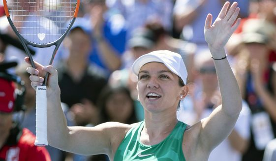 Simona Halep of Romania celebrates her victory over Ashleigh Barty of Australia during semifinals play at the Rogers Cup tennis tournament Saturday, Aug. 11, 2018 in Montreal. (Paul Chiasson/The Canadian Press via AP)