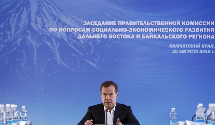 "Russian Prime Minister Dmitry Medvedev speaks during a meeting in Kamchatka Peninsula region, Russian Far East, Russia, Friday, Aug. 10, 2018. Russia's prime minister sternly warned the United States on Friday against ramping up sanctions, saying that Moscow will retaliate with economic, political and unspecified ""other"" means. (Dmitry Astakhov, Sputnik, Government Pool Photo via AP)"