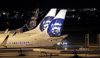 Alaska Airlines planes sit on the tarmac at Sea-Tac International Airport Friday evening, Aug. 10, 2018, in SeaTac, Wash. An airline mechanic stole an Alaska Airlines plane without any passengers and took off from Sea-Tac International Airport in Washington state on Friday night before crashing near Ketron Island, officials said. (AP Photo/Elaine Thompson)